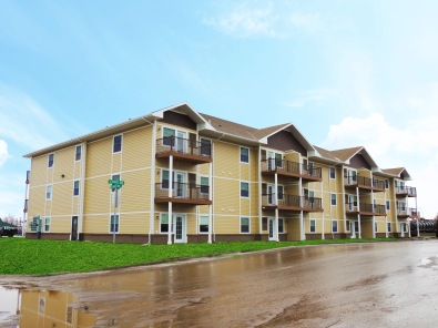 Apartment building construction completed in killdeer for Multi family living
